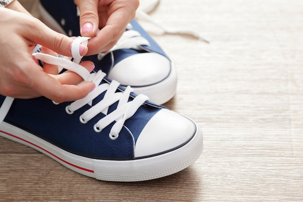 Woman tying shoelaces