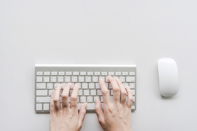 Woman typing on computer keyboard can be used for e-commerce, business, technology and internet concept