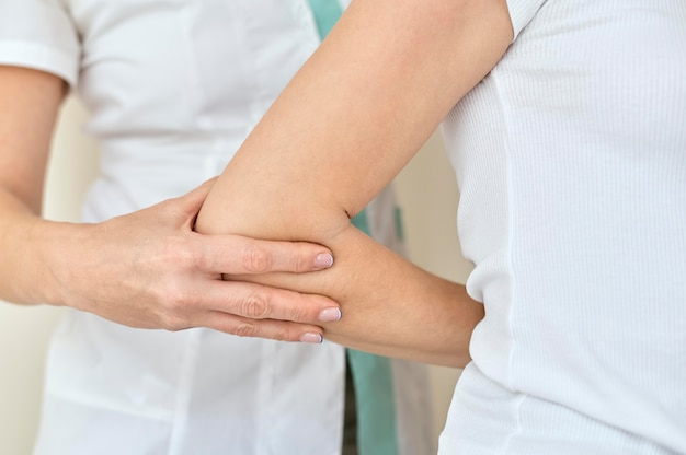 Woman undergoing therapy with physiologist