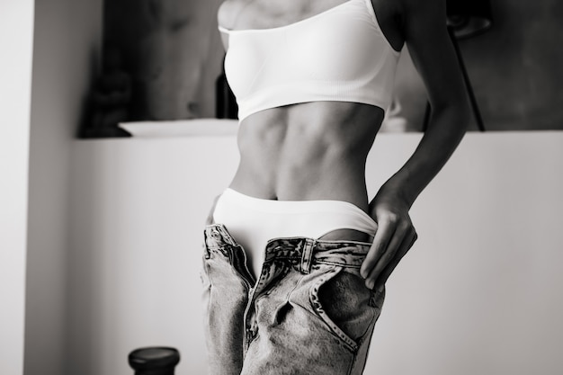 Woman undressing jeans, white underwear. young woman is taking her jeans off. woman look sensuality and sexy.