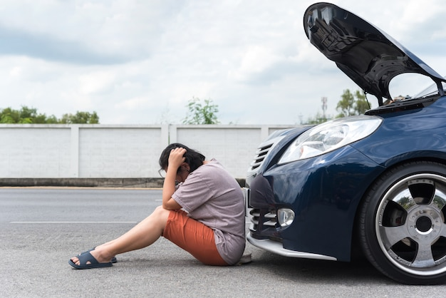 Woman unhappy and dismal from car engine problem