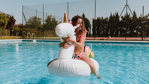 Woman on unicorn in water