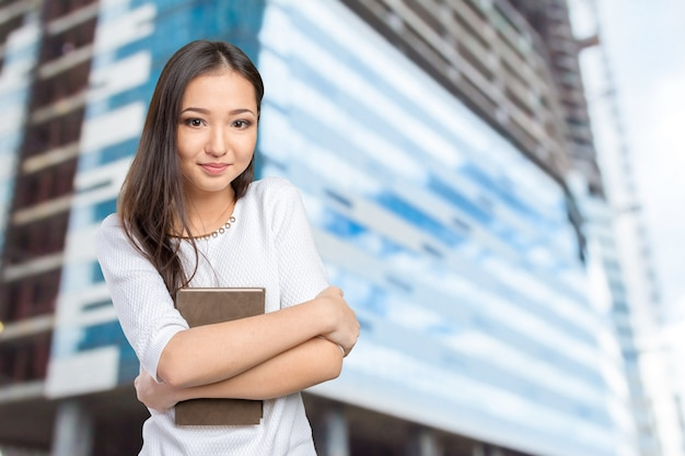 Woman university / college student holding book