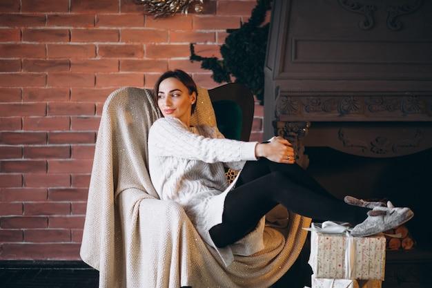 Woman unpacking presents on christmas
