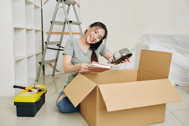 Woman unpacking in rented apartment