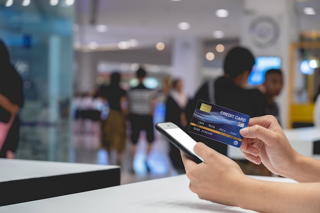 Woman use credit card shopping online with smart phone