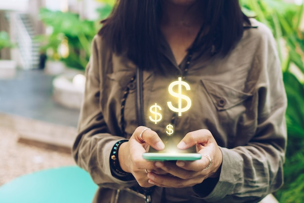Woman use gadget mobile smartphone earn money online with dollar icon pop up.