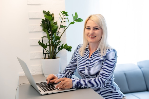 Woman use laptop. student researching process work. young business woman working creative startup modern office. analyze market stock, new strategy.