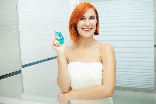Woman use skin care products at home