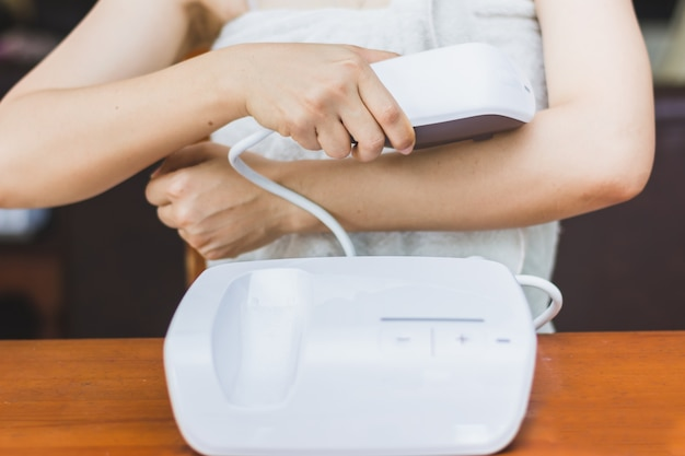 Woman useing personal ipl lase epilation prepare for skin care at home