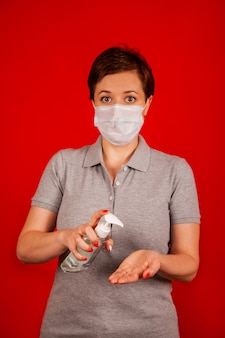 A woman uses a gel, disinfectant, antiseptic. hand sanitizer prevents viral and plague infections,