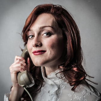 Woman using a classic phone