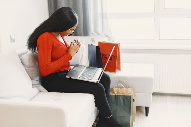 Woman using computer and credit card