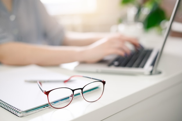 Woman using computer at home, office, no face. high quality photo