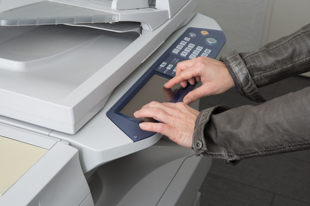 Woman using a copy machine