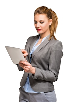Woman using a digital tablet, isolated on a white background