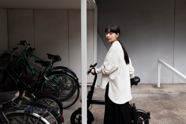 Woman using electric bicycle in the city