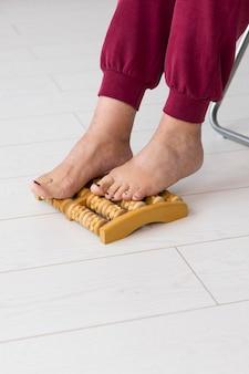 Woman using a feet massage device