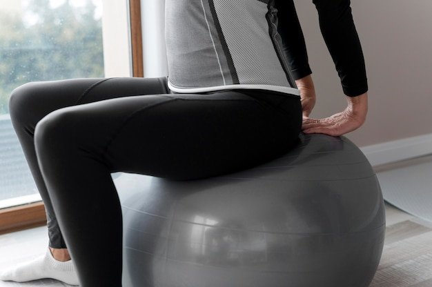 Woman using a fitness ball for her exercises