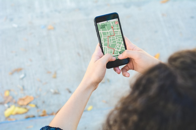 Woman using gps map navigation app with planned route