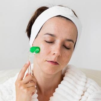 Woman using her headband and massaging the face close-up