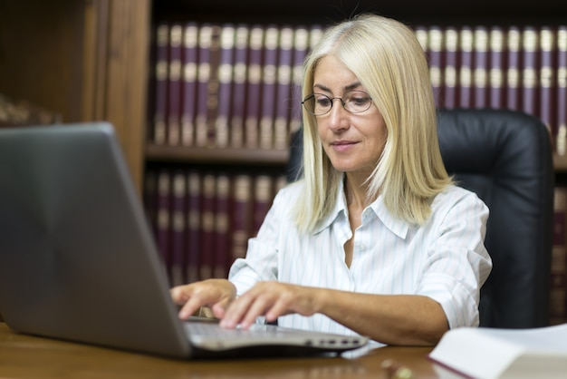 Woman using her laptop computer