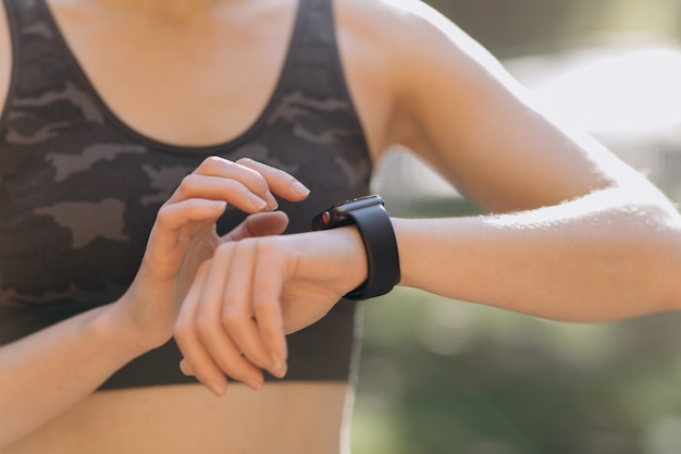 Woman using her smartwatch touchscreen wearable technology device