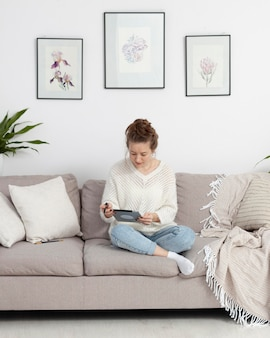 Woman using her tablet to write a blog