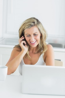 Woman using laptop during call with somebody