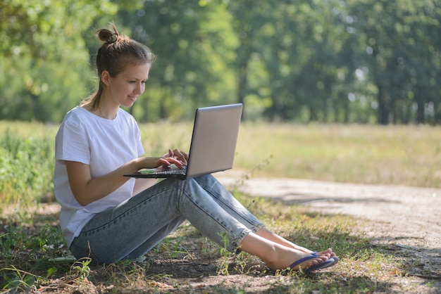 Woman using laptop in nature