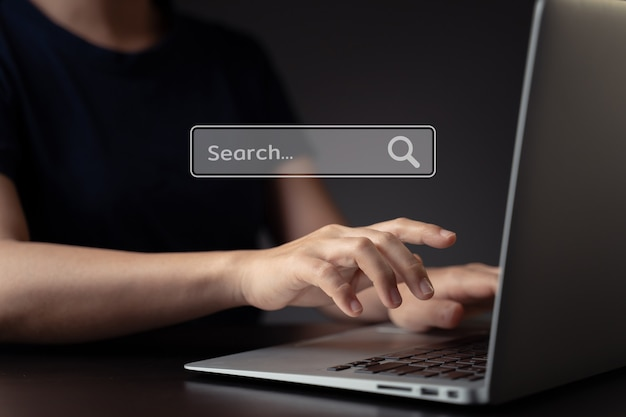 Woman using laptop for searching with browser icon hologram effec