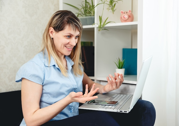 Woman using laptop for video call at home. video conference online
