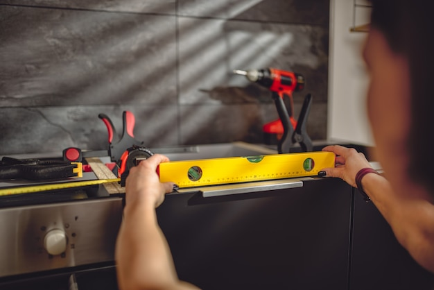 Woman using leveling tool