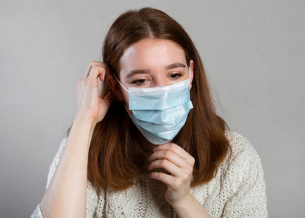 Woman using a medical mask for protection