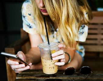 Woman using mobile phone and chill out at cafe