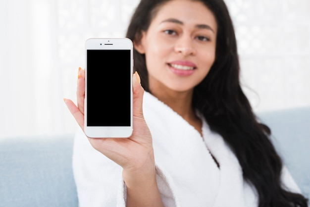 Woman using a mobile in a spa