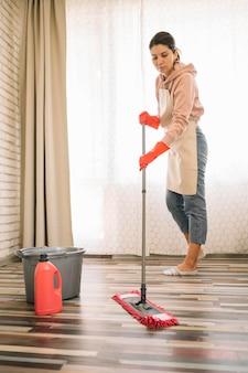 Woman using a mop