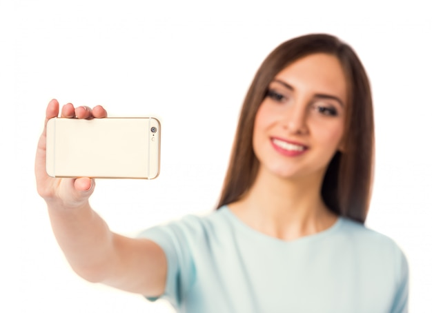 Woman using the phone for selfie