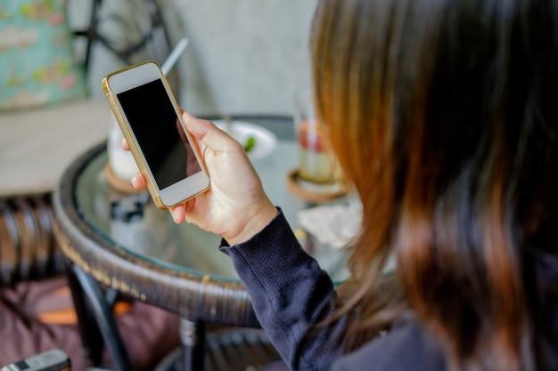Woman using phone.