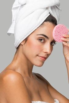 Woman using a pink sponge