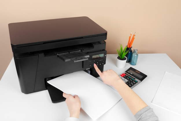 Woman using the printer to scanning and printing document