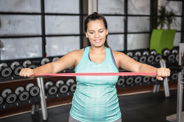 Woman using resistance band in the gym