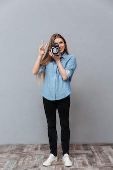 Woman using retro video camera