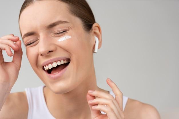 Woman using a skin care cream