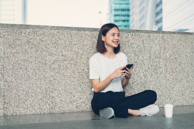 Woman using smartphone, during leisure time. the concept of using the phone is essential in everyday life.