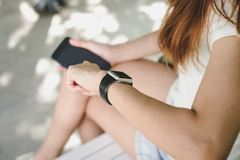 Woman using smartwatch with e-mail notifier