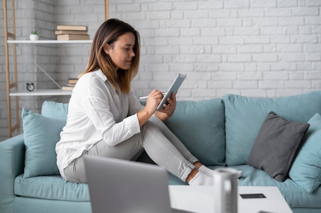 Woman using a speaker digital assistant