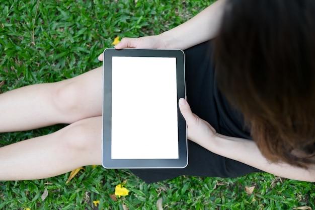 Woman using tablet in garden