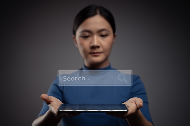 Woman using tablet for searching with browser icon hologram effec