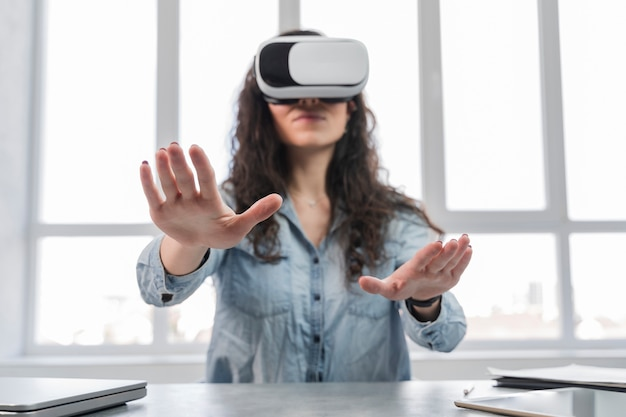 Woman using vr in a business office low view